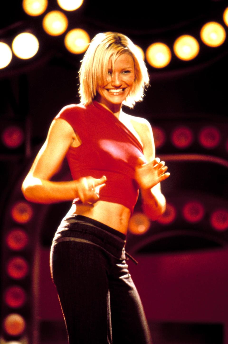 <p>Cameron's red one-shouldered crop top with low-slung black pants is so '00s.</p>
