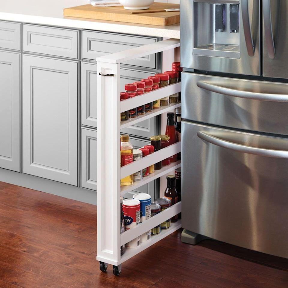 """<p>hammacher.com</p><p><strong>$129.95</strong></p><p><a href=""""https://go.redirectingat.com?id=74968X1596630&url=https%3A%2F%2Fwww.hammacher.com%2Fproduct%2Ftight-space-kitchen-pantry&sref=https%3A%2F%2Fwww.goodhousekeeping.com%2Fhome%2Fg35292976%2Ftop-kitchen-organization-tips%2F"""" rel=""""nofollow noopener"""" target=""""_blank"""" data-ylk=""""slk:BUY NOW"""" class=""""link rapid-noclick-resp"""">BUY NOW</a></p><p>This skinny shelf system slides into any 4-inch-wide space under your counters, so you can turn an unused gap into a mini pantry. </p>"""