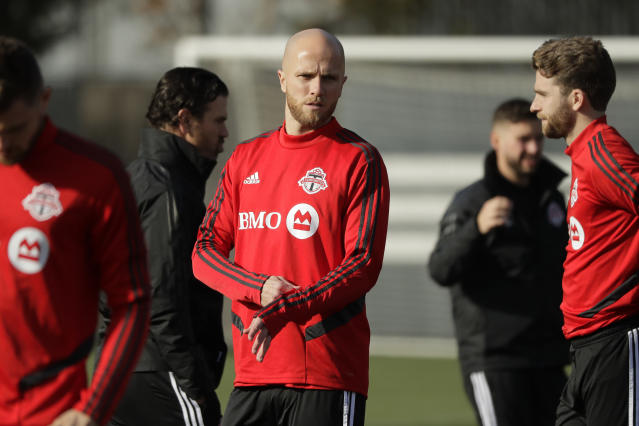 Toronto FC midfielder Michael Bradley, center, stands on the pitch with teammates during a training session Friday, Nov. 8, 2019, in Tukwila, Wash. Toronto FC will face the Seattle Sounders on Sunday in the MLS Cup soccer match at CenturyLink Field in Seattle. (AP Photo/Ted S. Warren)
