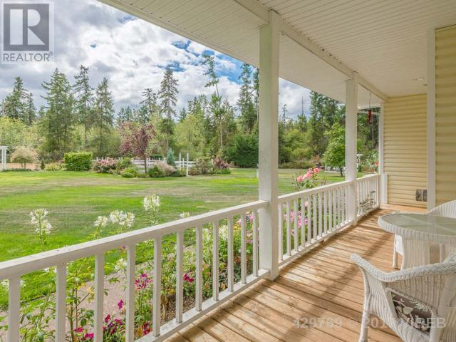 <p><span>1285 Leffler Rd., Errington, B.C.</span><br> This 2,280-square-foot classic Cape Cod-style home sits on five private acres.<br> (Photo: Zoocasa) </p>