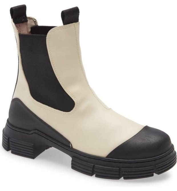 """<p>Ganni Waterproof Recycled Rubber City Boot, $170 (from $245), <a href=""""https://rstyle.me/+JJUYsGDJs6A6pMQ8rskdRA"""" rel=""""nofollow noopener"""" target=""""_blank"""" data-ylk=""""slk:available here"""" class=""""link rapid-noclick-resp"""">available here</a>. </p>"""