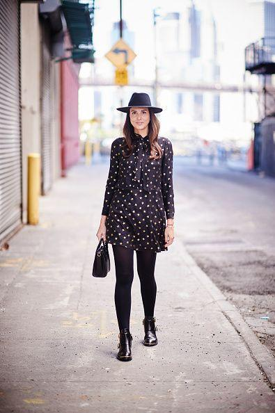 <p>2015 seems so last year, despite this fresh black high-neck chiffon dress, wide-brimmed hat, and booties. </p>