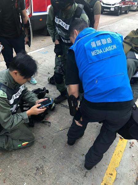 A police officer was shot in the leg by an arrow in Hong Kong