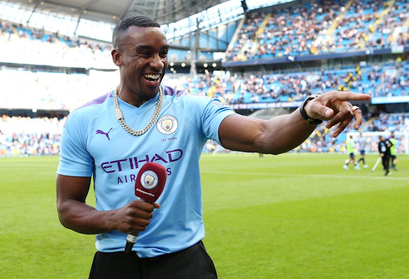 MANCHESTER, ENGLAND - AUGUST 17: British rap artist Bugzy Malone reacts at half time during the Premier League match between Manchester City and Tottenham Hotspur at Etihad Stadium on August 17, 2019 in Manchester, United Kingdom. (Photo by Matt McNulty - Manchester City/Manchester City FC via Getty Images)