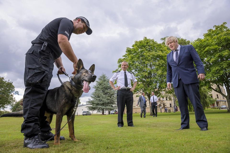 Prime Minister Boris Johnson with Chief Constable Iain Livingstone and dog handler Pc Chris Morrison with dog Eli (James Glossop/The Times/PA) (PA Wire)