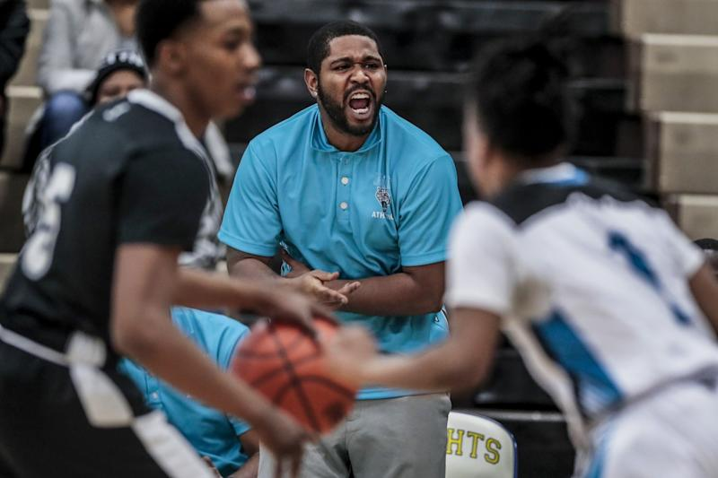 Flint basketball coach Demarkus Jackson shouts instructions to his players during a game against Atherton High.