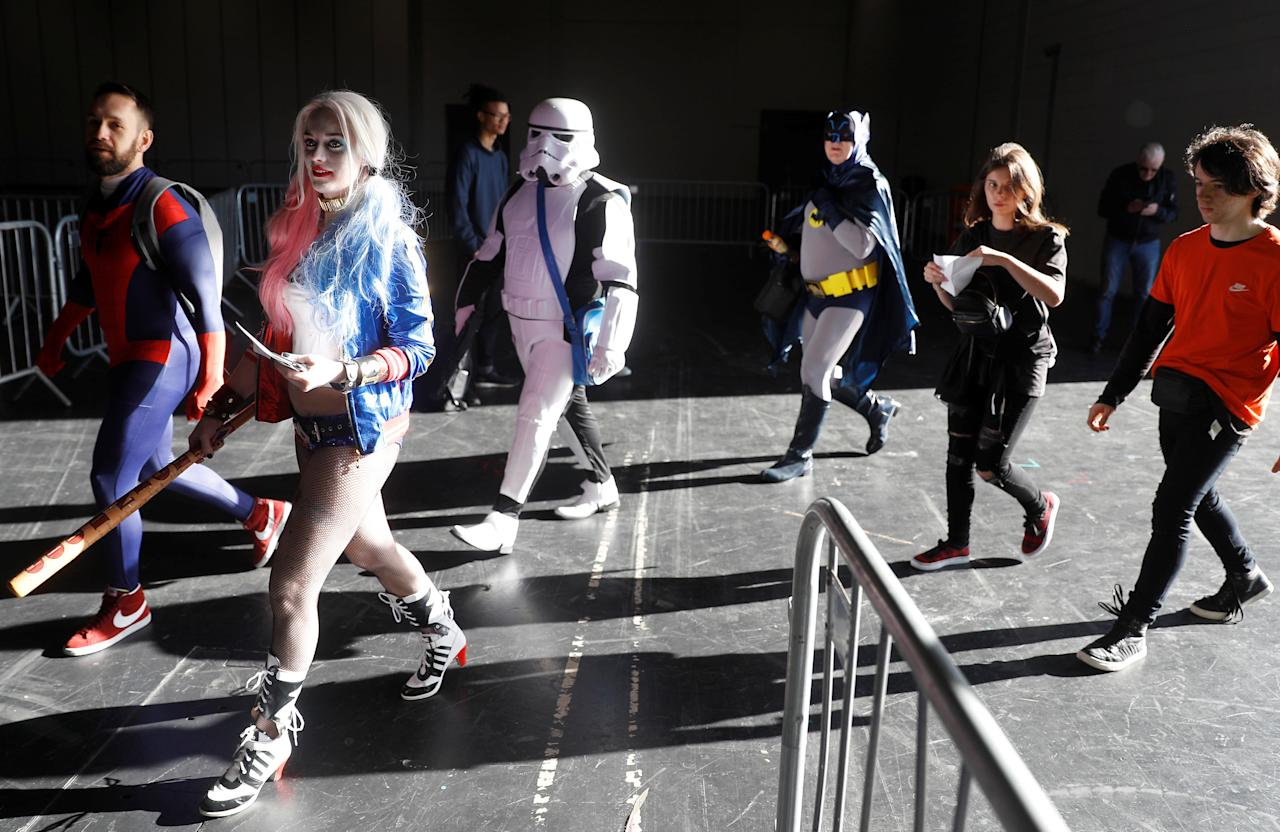 Visitors in costume arrive at the London Comic Con, at the ExCel exhibition centre in east London, Britain October 27, 2017. REUTERS/Peter Nicholls