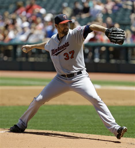 Minnesota Twins starting pitcher Mike Pelfrey delivers in the first inning of a baseball game against the Cleveland Indians, Sunday, May 5, 2013, in Cleveland. (AP Photo/Tony Dejak)