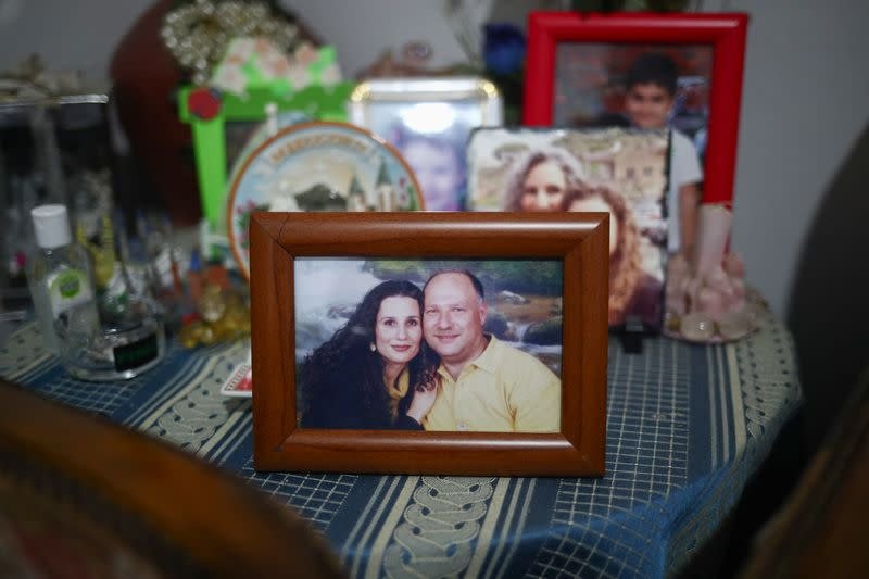 A photograph of the missing silo employee Ghassan Hasrouty pictured with his wife Ibtissam in the family home, following Tuesday's blast in Beirut's port area