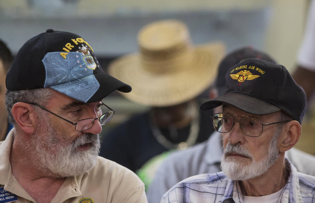 Vietnam veteran Gene Stoesser, right, talks with Veterans Crisis Command Center volunteer Chuck Lewis, left, while he waits for an appointment Tuesday, June 10, 2014, at American Legion Post 1 in Phoenix. Stoesser was told on May 2, 2014, that he needs heart surgery. The American Legion has set up a crisis center in Phoenix to help veterans get medical care in a first-of-its-kind event in the American Legion's nearly 100-year history.(AP Photo/The Arizona Republic, Mark Henle) MESA OUT MARICOPA COUNTY OUT MAGS OUT NO SALES
