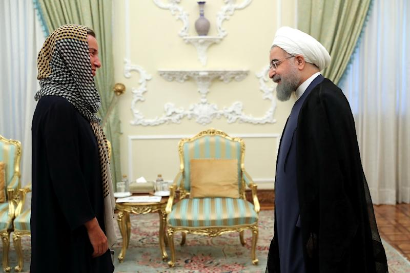A picture provided by the office of Iran's President Hassan Rouhani on August 5, 2017, shows him meeting EU foreign affairs chief Federica Mogherini in Tehran