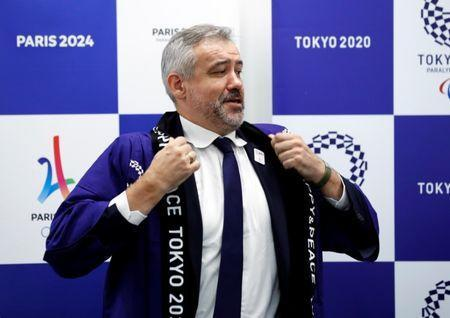 Etienne Thobois, Paris 2024 Director General, wears Japanese happi coat after receiving it as a souvenir during a ceremony marking conclusion of MoU between Tokyo 2020 and Paris 2024 Olympic Games in Tokyo, Japan, July 11, 2018. REUTERS/Kim Kyung-Hoon