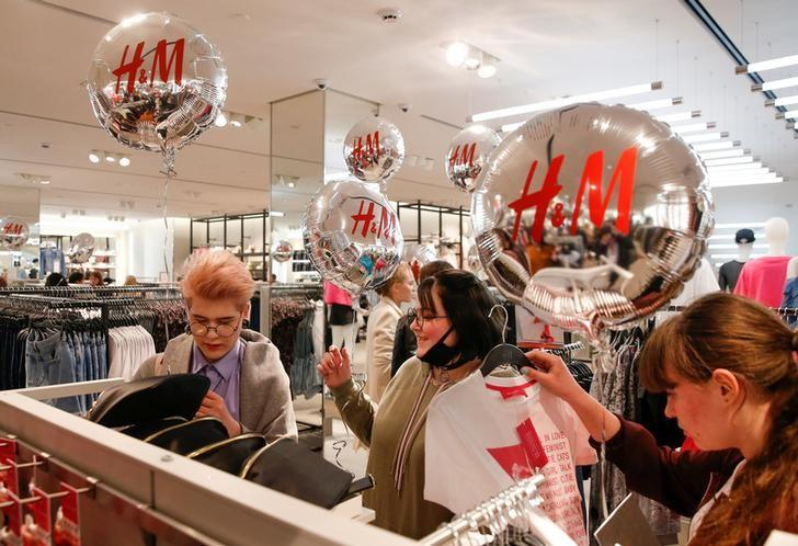 FILE PHOTO:People shop at the Swedish fashion retailer H&M store on its opening day in central Moscow