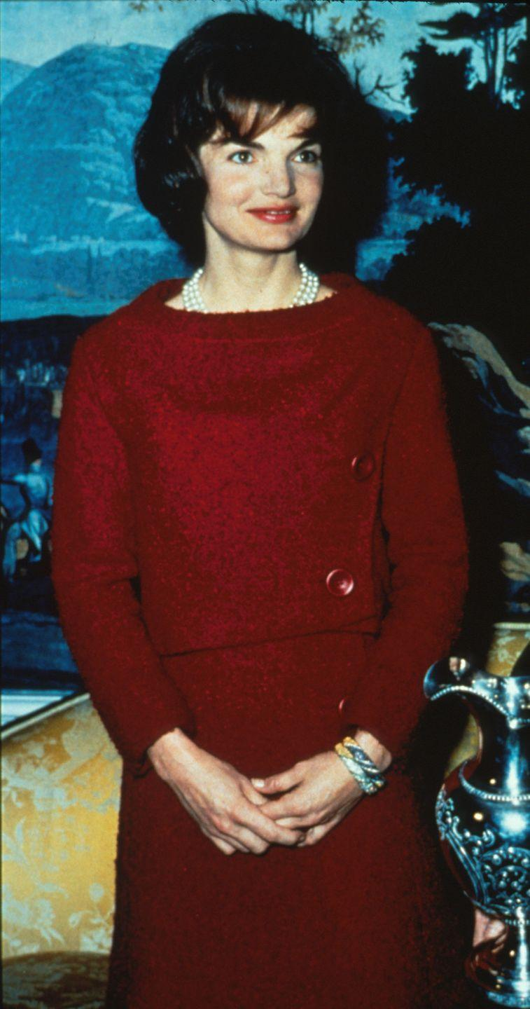 <p>Jacqueline Kennedy looked impeccable as always in a Chez Ninon two-piece dress during a televised Valentine's Day tour of the White House. </p>