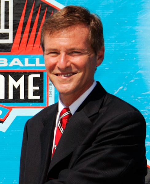 """FILE - In this Aug. 5, 2006 file photo, sports agent Leigh Steinberg poses during a ceremony at the Pro Football Hall of Fame in Canton, Ohio. It's been three years since Steinberg had his last drink of vodka, the personal demon that sent his personal and professional lives crashing out of control. After a stunning fall that included filing for bankruptcy, the super agent who was the inspiration for Tom Cruise's character in """"Jerry Maguire"""" plans to relaunch his sports and entertainment agency this year. (AP Photo/Mark Duncan, File)"""