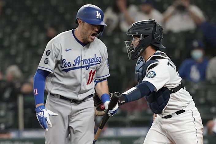 Dodgers batter AJ Pollock reacts after striking out during the sixth inning of a 4-3 loss to the Seattle Mariners on Monday.