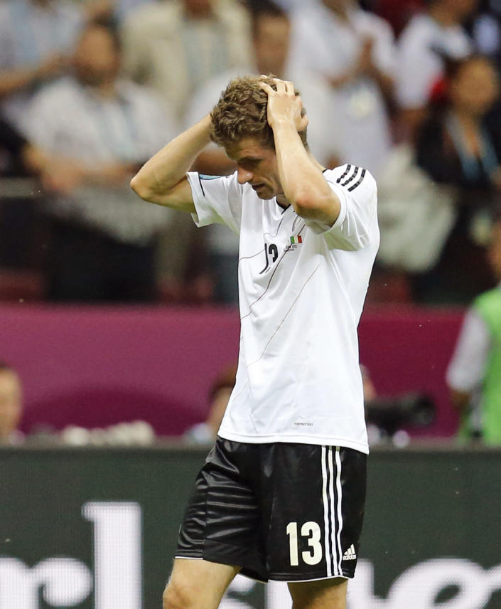 Germany's Thomas Mueller leaves the pitch after the Euro 2012 soccer championship semifinal match between Germany and Italy in Warsaw, Poland, Thursday, June 28, 2012. (AP Photo/Matthias Schrader)