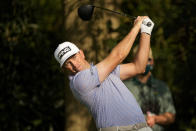 Michael Thompson watches his tee shot on the seventh hole during the first round of the Masters golf tournament on Thursday, April 8, 2021, in Augusta, Ga. (AP Photo/David J. Phillip)