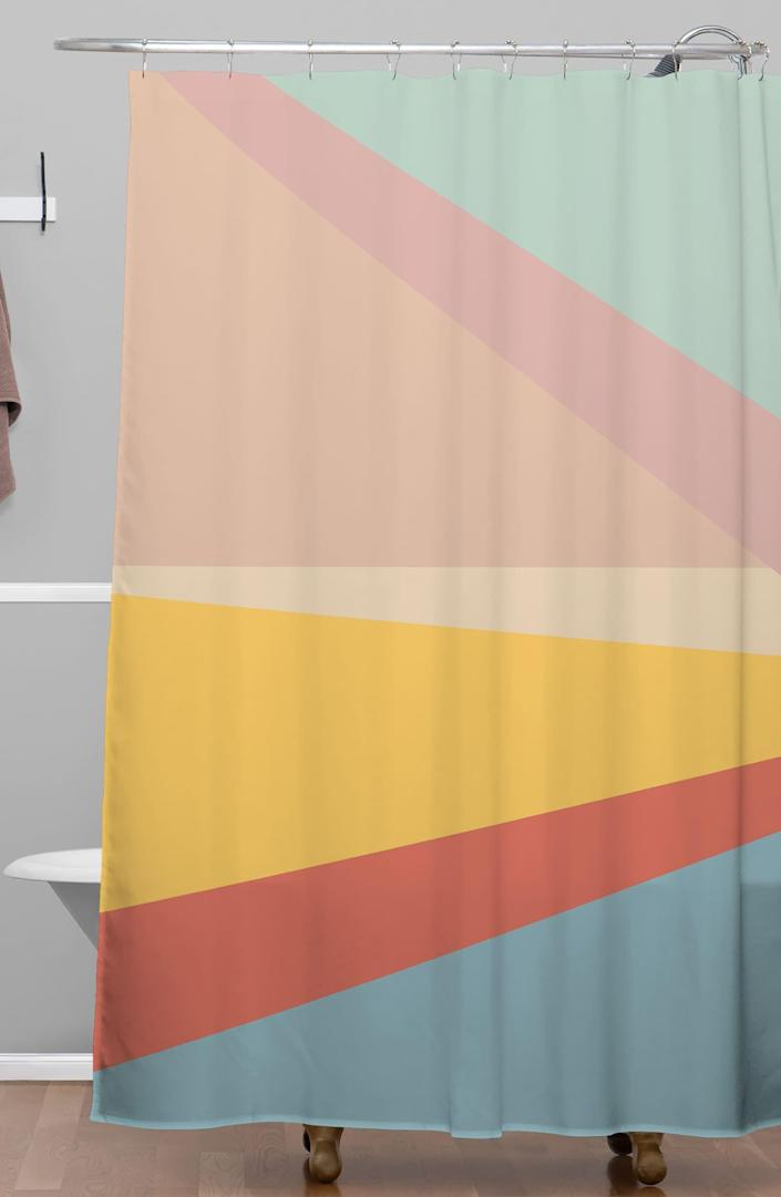 """We're staunch advocates of the <a href=""""https://www.architecturaldigest.com/gallery/stylish-shower-curtains?mbid=synd_yahoo_rss"""" rel=""""nofollow noopener"""" target=""""_blank"""" data-ylk=""""slk:shower curtain as statement piece"""" class=""""link rapid-noclick-resp"""">shower curtain as statement piece</a>, and this multicolor Deny Designs option delivers. $89, Nordstrom. <a href=""""https://www.nordstrom.com/s/deny-designs-june-journal-shower-curtain/5499274"""" rel=""""nofollow noopener"""" target=""""_blank"""" data-ylk=""""slk:Get it now!"""" class=""""link rapid-noclick-resp"""">Get it now!</a>"""