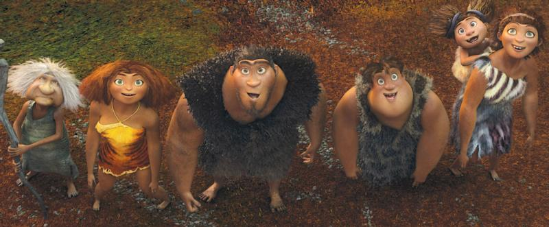 """This film publicity image released by DreamWorks Animation shows, from left, Gran, voiced by Cloris Leachman, Eep, voiced by Emma Stone, Grug, voiced by Nicolas Cage, Thunk, voiced by Clark Duke, and Ugga, voiced by Catherine Keener, who is carrying Sandy, voiced by Randy Thom, in a scene from """"The Croods."""" (AP Photo/DreamWorks Animation)"""