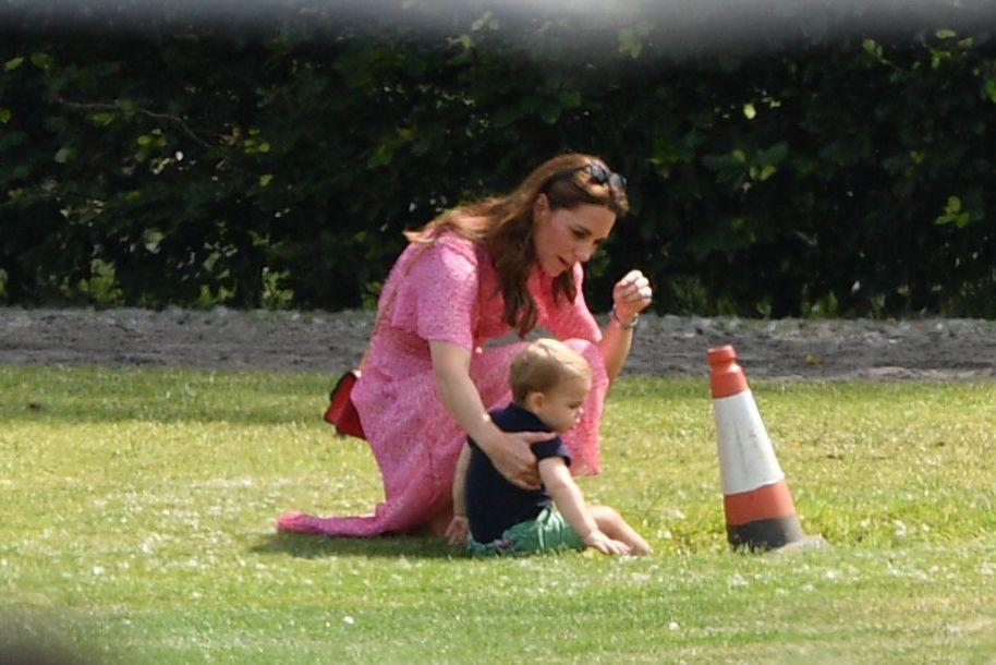 <p>Catherine, Duchess of Cambridge played with Prince Louis on the sidelines at the polo match.  </p>