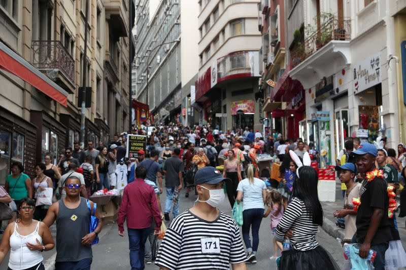 People gather in Ladeira Porto Geral in downtown Sao Paulo