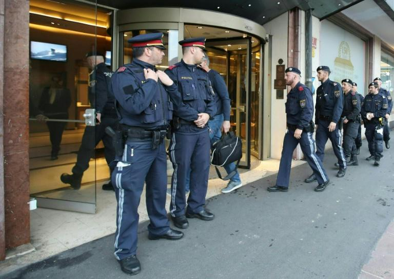 Police officers close a hotel near the city centre in Innsbruck on February 25 after a woman who worked there was confirmed to have coronavirus