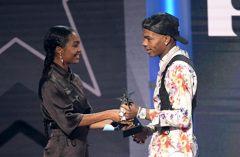 LOS ANGELES, CALIFORNIA - JUNE 23: Lil Baby (R) accepts Best New Artist from Yara Shahidi onstage at the 2019 BET Awards on June 23, 2019 in Los Angeles, California. (Photo by Kevin Winter/Getty Images) ORG XMIT: 775352826 ORIG FILE ID: 1157861822