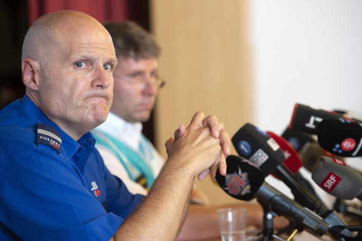 Andreas Tobler, head of operations of the cantonal police of Grisons addresses the media during a press conference in Flims, Switzerland, Sunday, Aug. 5, 2018 about the plane crash on Saturday afternoon. The plane, a Junkers Ju-52, crashed on Saturday, Aug. 4, 2018 at the Piz Segnas, all 20 people aboard died. (Melanie Duchene/Keystone via AP)