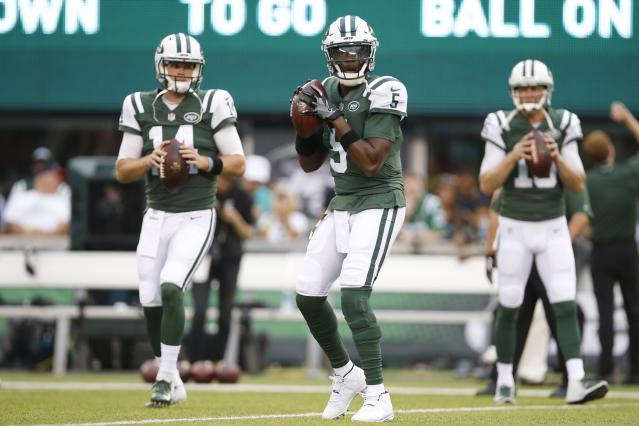 The New York Jets have reportedly traded Teddy Bridgewater, center, to the Saints. (AP)