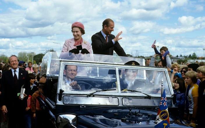 Queen Elizabeth ll and Prince Philip, Duke of Edinburgh wave to wellwishers from their open car in October 1981 in Wellington, New Zealand - Anwar Hussein/Getty Images