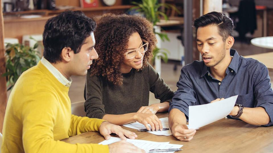 Couple on meeting with financial advisor.