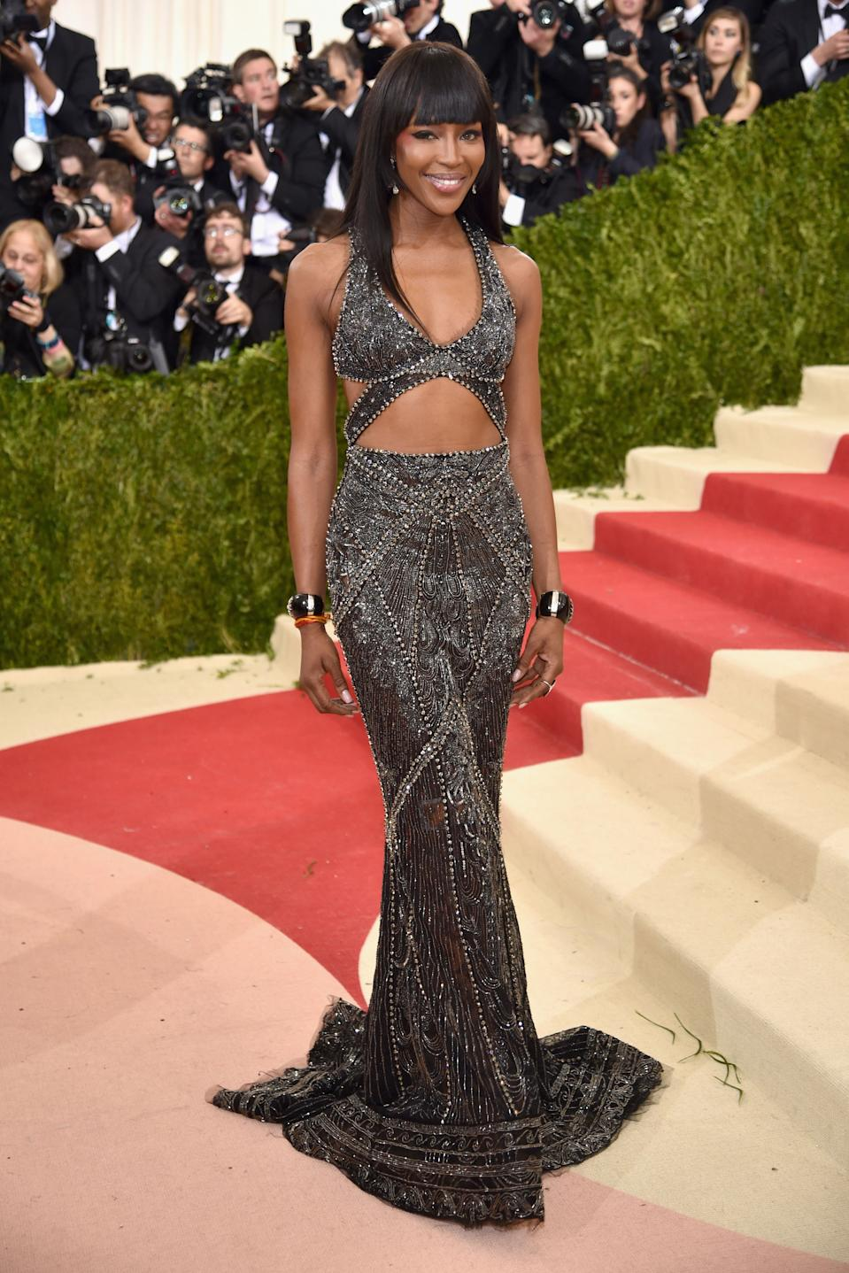 """<h1 class=""""title"""">Naomi Campbell in a Roberto Cavalli Couture dress and Verdura bracelets</h1><cite class=""""credit"""">Photo: Getty Images</cite>"""