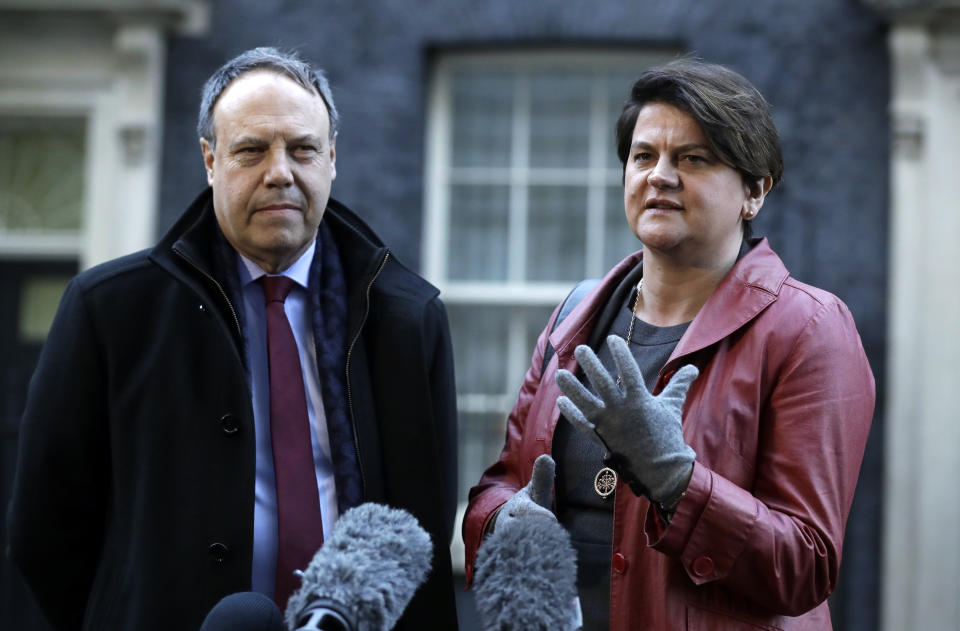 DUP Party leader Arlene Foster and Deputy Leader Nigel Dodds, left, make a statement to the media after exiting 10 Downing Street. London, Thursday Jan. 17, 2019. British Prime Minister Theresa May is reaching out to opposition parties and other lawmakers Thursday in a battle to put Brexit back on track after surviving a no-confidence vote. (AP Photo/Matt Dunham)