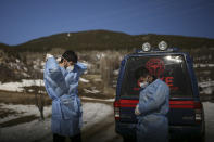 Dr. Yasin Kaya, left and health worker Yusuf Duran, right, members of the the Koyulhisar Public Health Center vaccination team, prepare to vaccinate 85-year-old Ibrahim Yigit in the isolated village of Gumuslu in the district of Sivas, central Turkey, Friday, Feb. 26, 2021. (AP Photo/Emrah Gurel)
