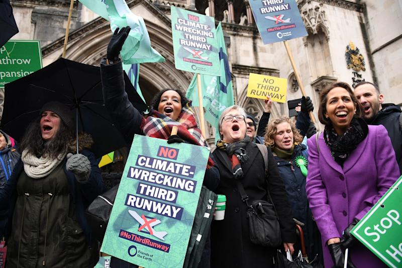 Campaigners celebrate outside the Royal Courts of Justice (PA)