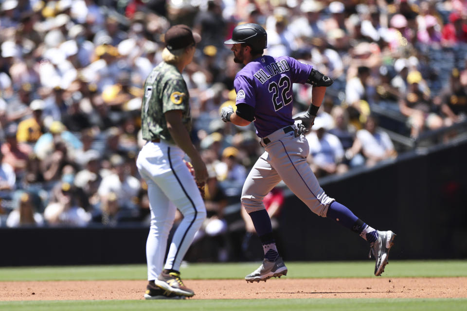 Colorado Rockies' Sam Hilliard, right, runs the bases after hitting a home run as San Diego Padres shortstop Ha-Seong Kim looks on in the second inning of a baseball game Sunday, Aug. 1, 2021, in San Diego. (AP Photo/Derrick Tuskan)