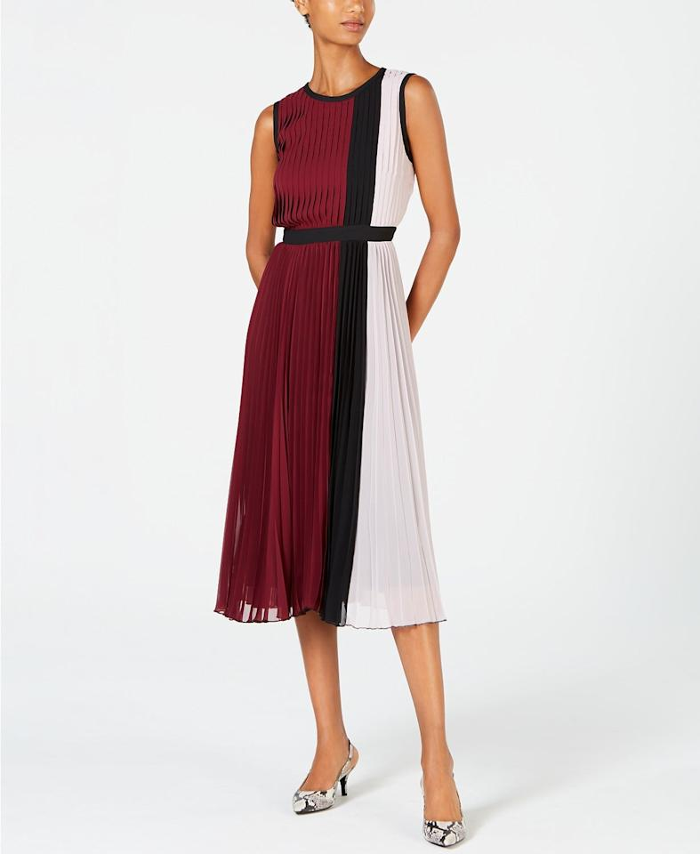 """<p>The elastic band on this <a href=""""https://www.popsugar.com/buy/Alfani-Colorblocked-Pleated-Sleeveless-Dress-498072?p_name=Alfani%20Colorblocked%20Pleated%20Sleeveless%20Dress&retailer=macys.com&pid=498072&price=48&evar1=fab%3Aus&evar9=46715727&evar98=https%3A%2F%2Fwww.popsugar.com%2Fphoto-gallery%2F46715727%2Fimage%2F46717311%2FAlfani-Colorblocked-Pleated-Sleeveless-Dress&list1=shopping%2Cdresses%2Cparty%20dresses%2Cmacys&prop13=api&pdata=1"""" rel=""""nofollow"""" data-shoppable-link=""""1"""" target=""""_blank"""" class=""""ga-track"""" data-ga-category=""""Related"""" data-ga-label=""""https://www.macys.com/shop/product/alfani-colorblocked-pleated-sleeveless-dress-created-for-macys?ID=9423499&amp;CategoryID=5449"""" data-ga-action=""""In-Line Links"""">Alfani Colorblocked Pleated Sleeveless Dress</a> ($48, originally $120) makes it quite comfortable.</p>"""
