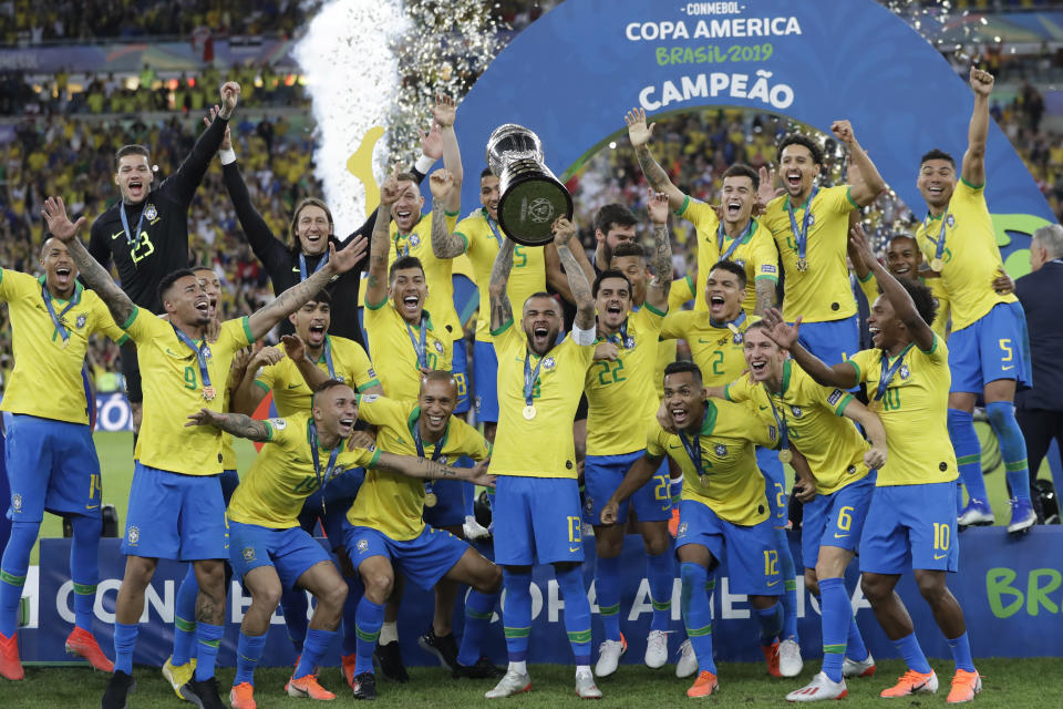 Brazil's Dani Alves lifts up the trophy after winning the final soccer match of the Copa America against Peru at the Maracana stadium in Rio de Janeiro, Brazil, Sunday, July 7, 2019. Brazil won the match 3-1. (AP Photo/Andre Penner)