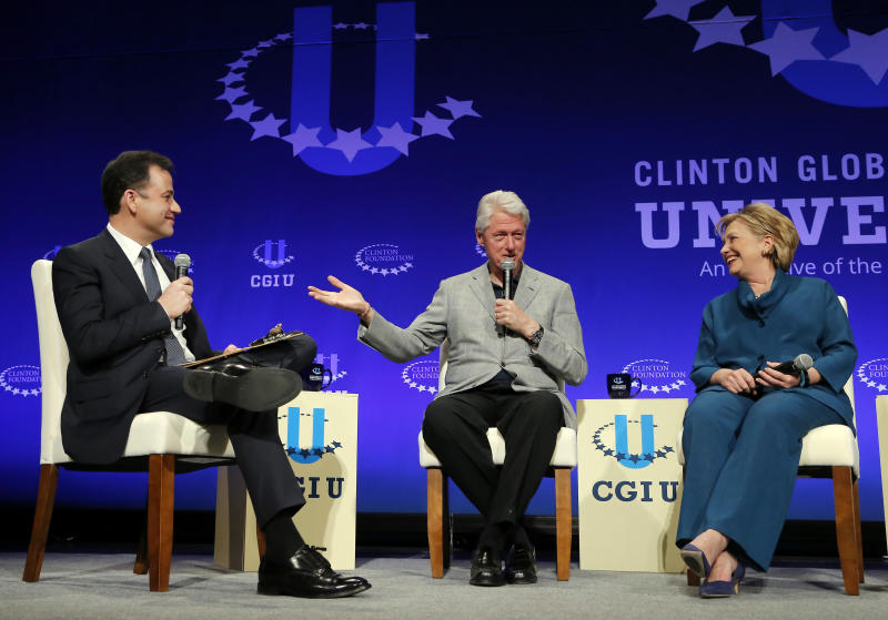 Former President Bill Clinton, center, and former Secretary of State Hillary Rodham Clinton, right, speak with talk show host Jimmy Kimmel during a student conference for the Clinton Global Initiative University, Saturday, March 22, 2014, at Arizona State University in Tempe, Ariz. More than 1,000 college students are gathered at Arizona State University this weekend as part of the Clinton Global Initiative University's efforts to advance solutions to pressing world challenges. (AP Photo/Matt York)