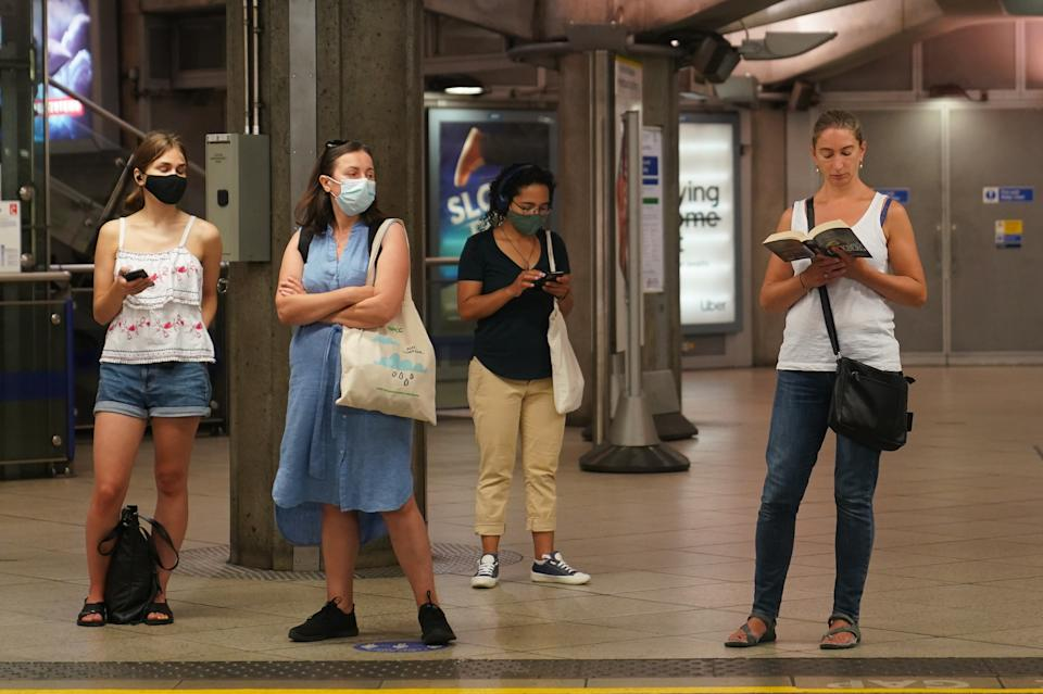 Commuters, some not wearing facemasks, at Westminster Underground station, at 0851 in London after the final legal Coronavirus restrictions were lifted in England. Picture date: Monday July 19, 2021.