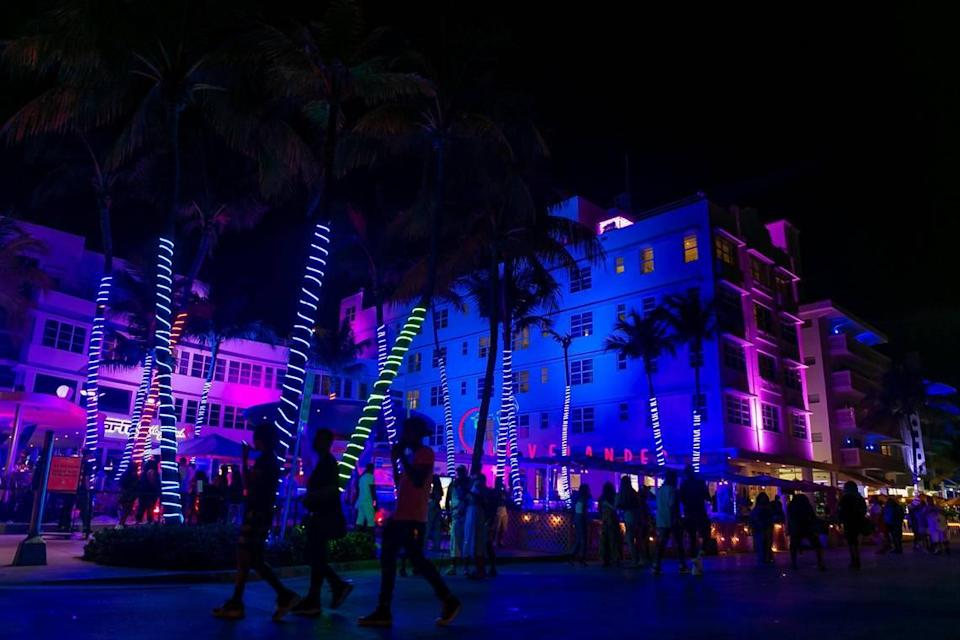 South Beach visitors walk down Ocean Drive near the Clevelander in Miami Beach during the start of Memorial Day Weekend on Friday, May 28, 2021.
