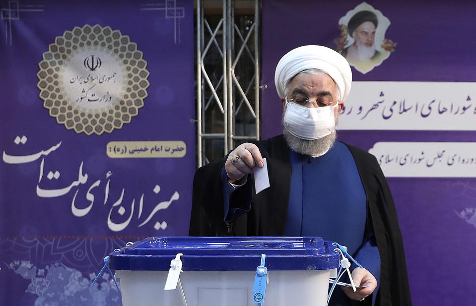 In this photo released by the official website of the office of the Iranian Presidency, President Hassan Rouhani casts his ballot for the presidential elections at the Interior Ministry in Tehran, Iran, June 18, 2021. Iran began voting Friday in a presidential election tipped in the favor of a hard-line protege of Supreme Leader Ayatollah Ali Khamenei, fueling public apathy and sparking calls for a boycott in the Islamic Republic. (Iranian Presidency Office via AP)