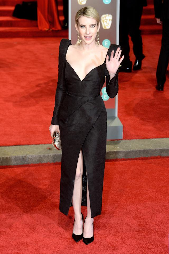 <p>Shoulder pads and a plunging neckline, courtesy of Schiaparelli, led to a sartorial victory for Julia Roberts's niece on the red carpet. <em>[Photo: Getty]</em> </p>