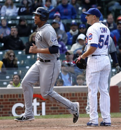 San Diego Padres' Kyle Blanks scores past Chicago Cubs relief pitcher Shawn Camp after a passed ball charged to catcher Welington Castillo during the eighth inning of a baseball game Thursday, May 2, 2013, in Chicago. (AP Photo/Charles Rex Arbogast)