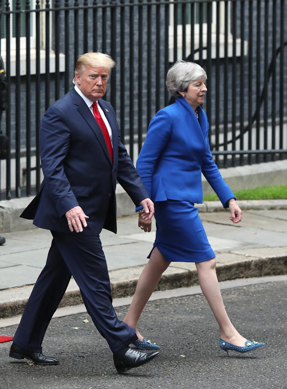 Prime Minister Theresa May with US President Donald Trump leave Downing Street in London for a joint press conference at the Foreign & Commonwealth Office, on the second day of his state visit to the UK.