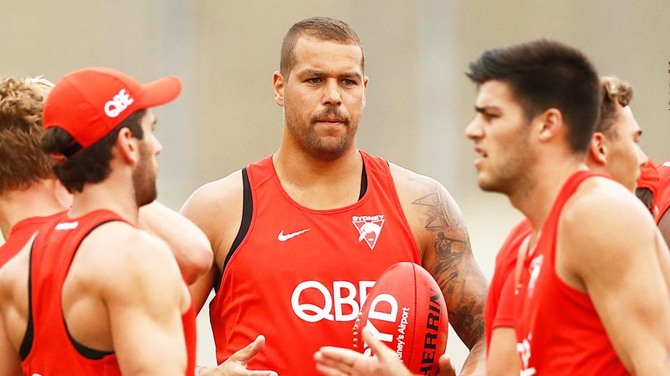 Lance Frankling (pictured middle) during a Sydney Swans training.