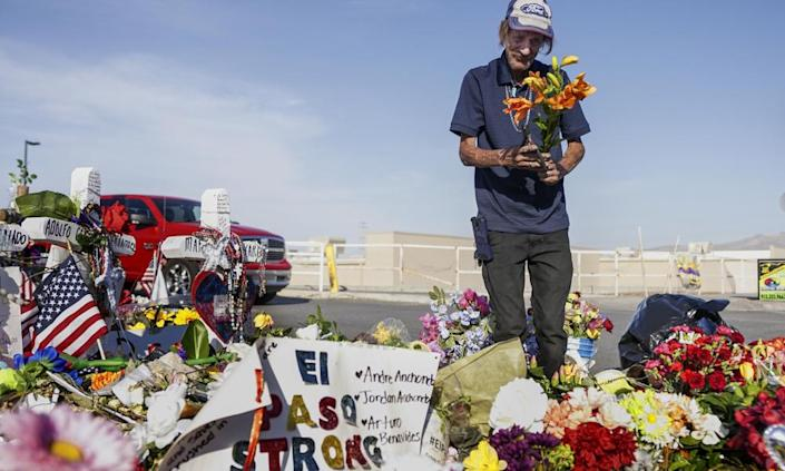 """<span class=""""element-image__caption"""">Antonio Basco, whose wife Margie Reckard was one of 22 killed at a local Walmart, lays flowers in her honor at a memorial on 16 August 2019 in El Paso, Texas.</span> <span class=""""element-image__credit"""">Photograph: Sandy Huffaker/Getty Images</span>"""
