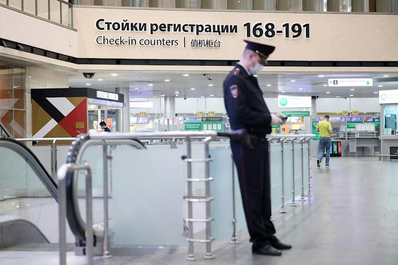 A police officer in a medical mask at Terminal F of Sheremetyevo International Airport. Russia suspends most flights to and from China from February 1, 2