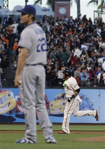 San Francisco Giants' Melky Cabrera, rear, rounds the bases after hitting a solo home run off Los Angeles Dodgers pitcher Clayton Kershaw (22) during the fourth inning of a baseball game in San Francisco, Tuesday, June 26, 2012. (AP Photo/Jeff Chiu)